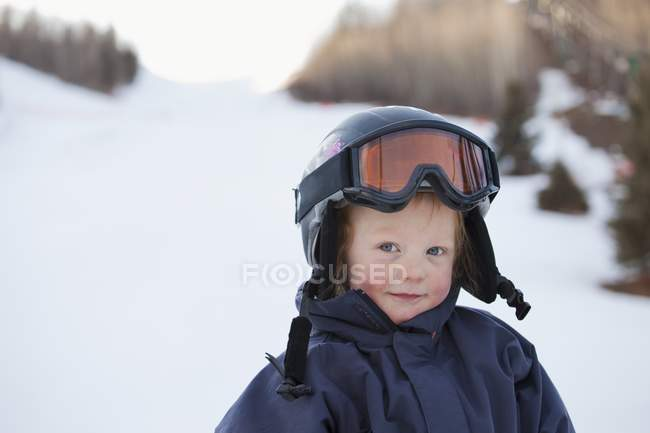 A Young Boy Wearing A Helmet And Ski Mask; Red Deer, Alberta, Canada — Stock Photo