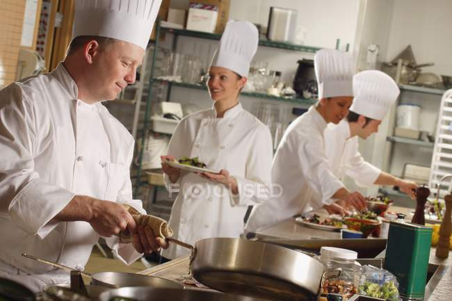Chefs Preparing Food In Modern Kitchen — Stock Photo