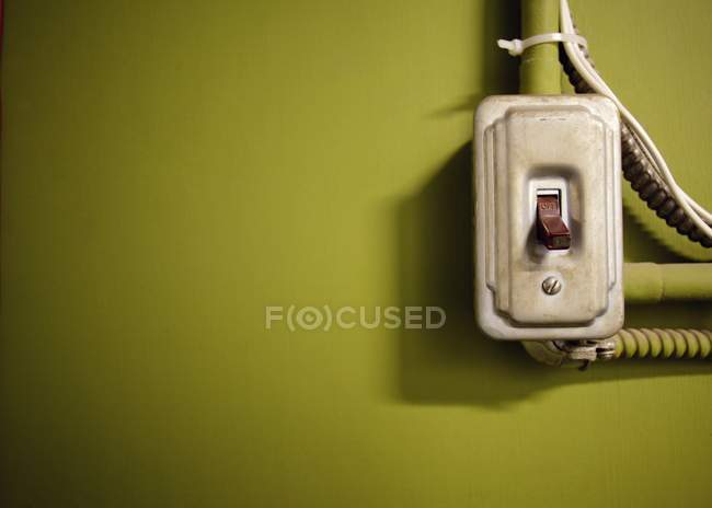 Vintage main switch on green wall — Stock Photo