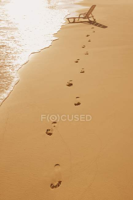 Sandy beach with footsteps — Stock Photo