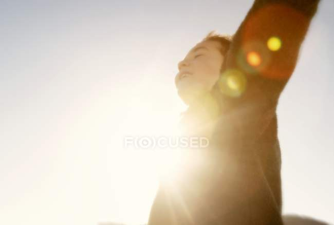 Child In The Sunshine with raised arms — Stock Photo