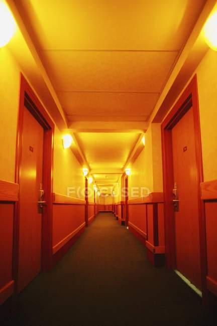 Hallway with wooden doors — Stock Photo