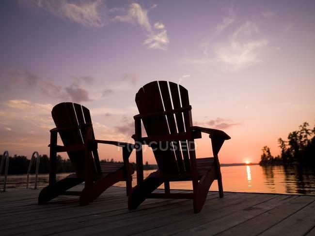 Adirondack Chairs on pier — Stock Photo