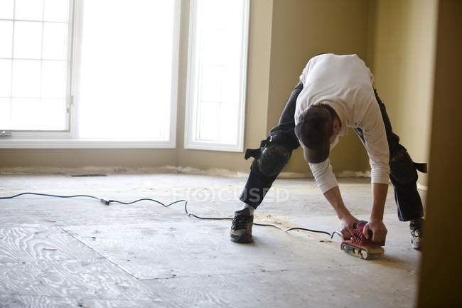 Man Sanding Floor — Stock Photo