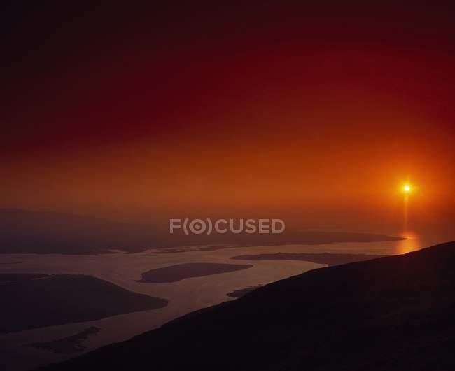 Захода солнца на закате — стоковое фото