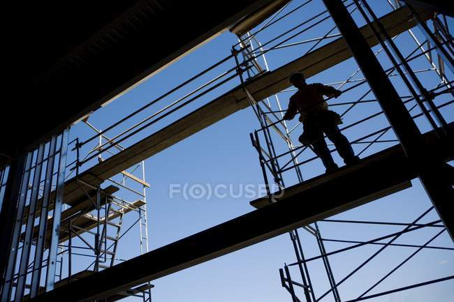 Low angle view of Construction Worker On Scaffolding — Stock Photo