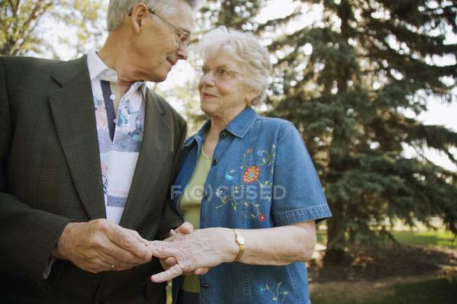 Senior Man Putting Wedding Ring On Woman Finger — Stock Photo