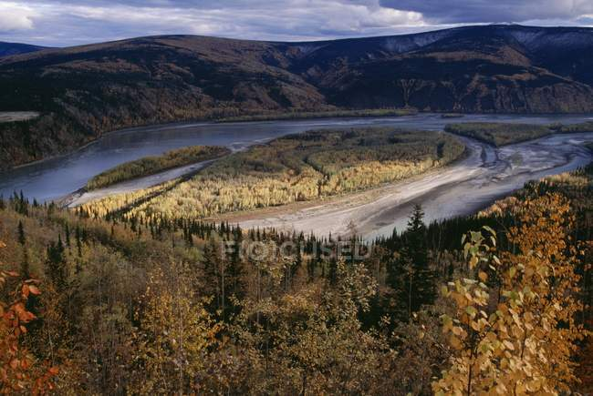 Yukon River with hills and wood — Stock Photo