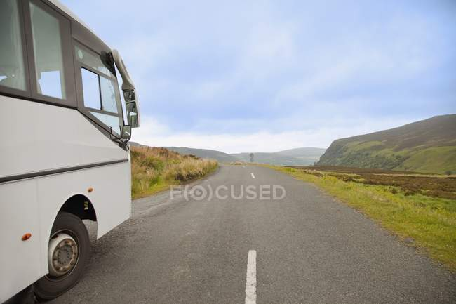 Bus Traveling Down Road — Stock Photo