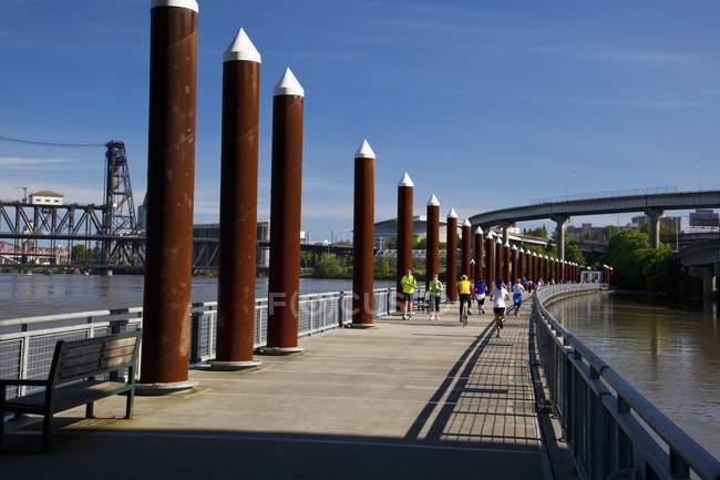 People Walking Over A Bridge — Stock Photo