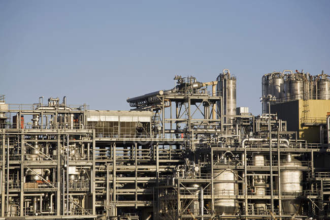Refinery pipeline with smoke, environmental pollution