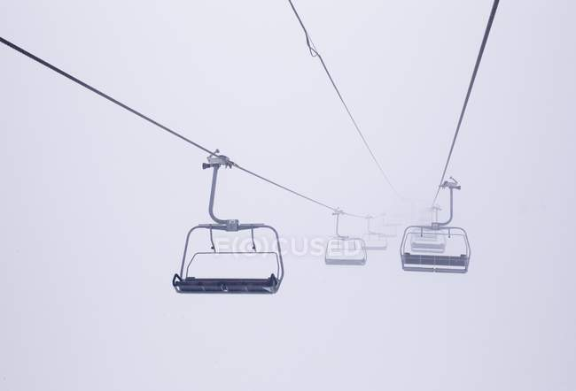 Ski Lift Chairs In The Fog, Distant View U2014 Stock Photo