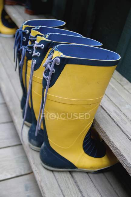 Two Pairs Of Yellow Boots — Stock Photo