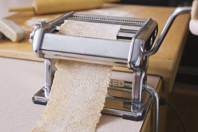 Pasta Machine With Brown Pasta Sheet Rolling Out — Stock Photo