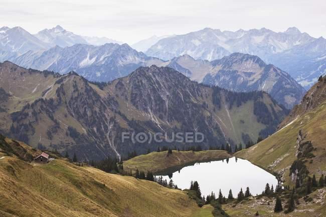 Mountain Lake And Alpine Hut — Stock Photo