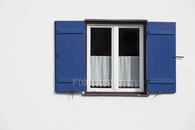 Bright Blue Shutters — Stock Photo