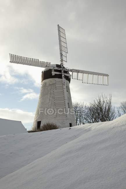Windmill In Winter over snow — Stock Photo