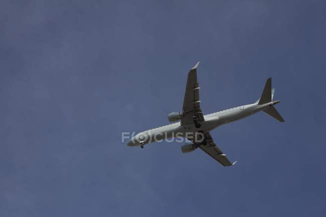 An Airplane In Flight in blue sky — Stock Photo