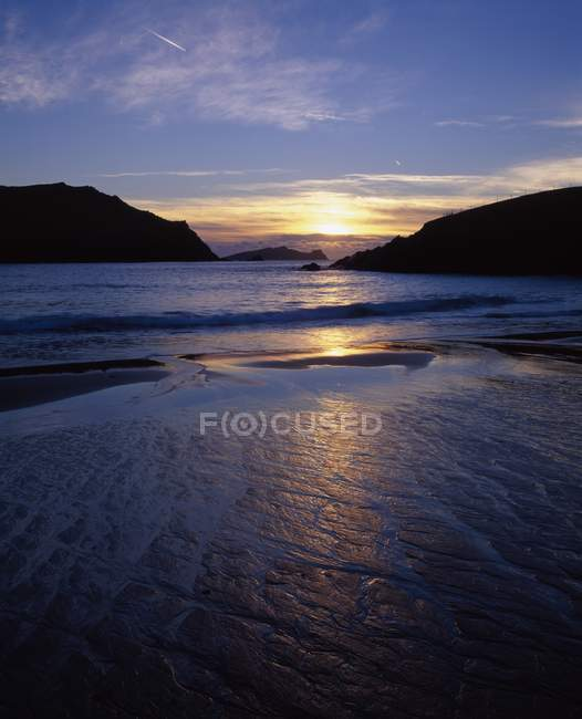 Sunset Over Water with hills — Stock Photo