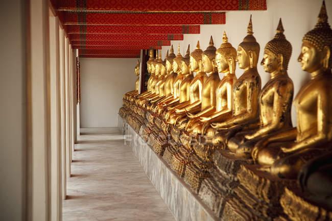 Seated Golden Buddha Statues, Bangkok — Stock Photo