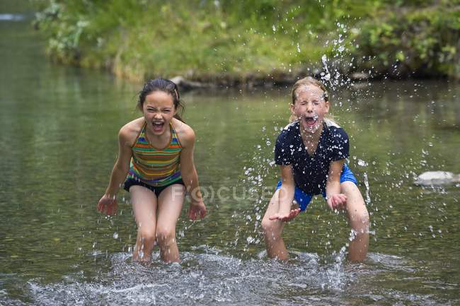 Two happy caucasian Girls Playing In Water — Stock Photo