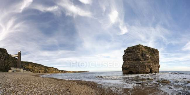 A Large Rock Off The Coast — Stock Photo