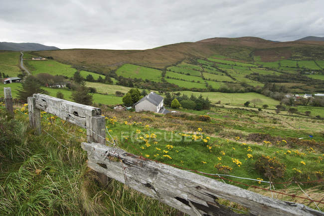 Farmland from a wooden fence — Stock Photo