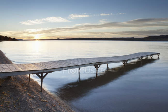 A dock in lake superior at sunset — Stock Photo