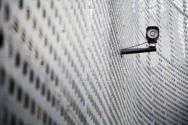Security camera on curving metal wall — Stock Photo
