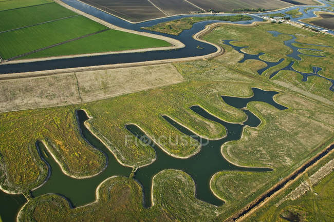 Farmland and river channels — Stock Photo