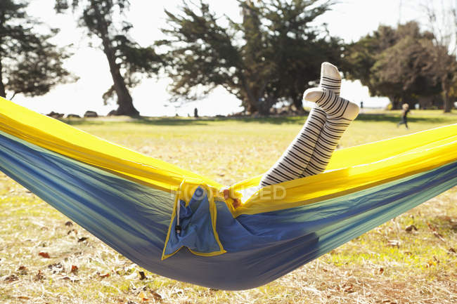 Legs of a young girl sticking up out of a hammock;Crab cove california united states of america — Stock Photo