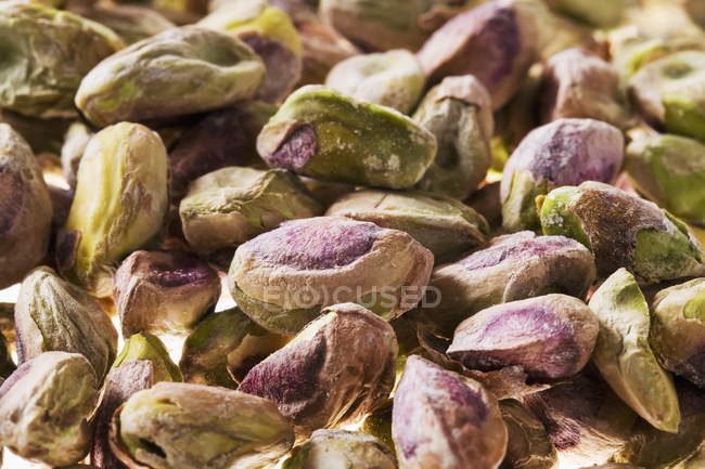 Closeup view of dried pistachio nuts heap — Stock Photo