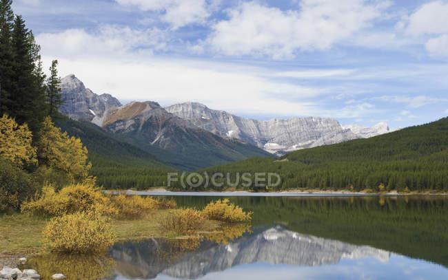 Lake water on foot of mountain — Stock Photo