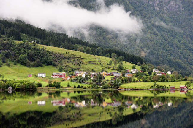 Houses In A Valley Along The Water — Stock Photo