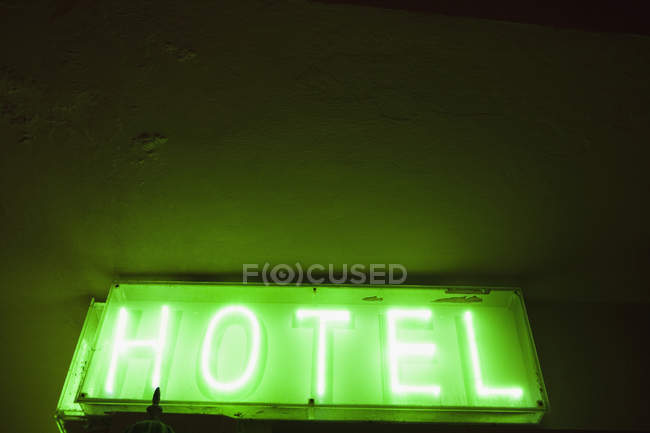 Hotel Sign with green light — Stock Photo
