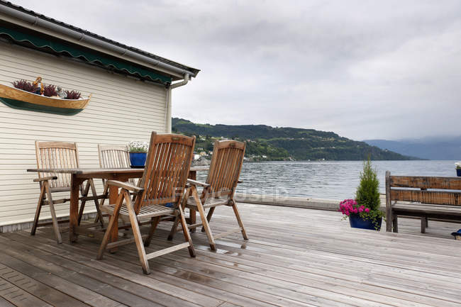 Table And Chairs On Wooden Deck — Stock Photo