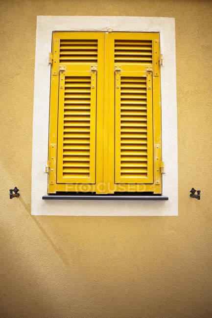 Bright Yellow Shutters — Stock Photo