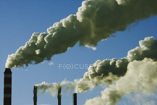 Refinery pipeline with smoke, environmental pollution — nobody, sky