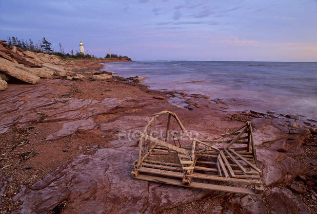 Point Prim Lighthouse And Old Lobster Trap — Stock Photo