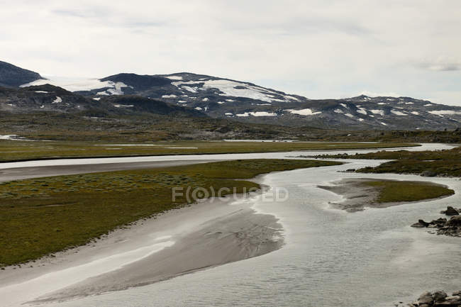 Waterways And Snow On The Mountains — Stock Photo