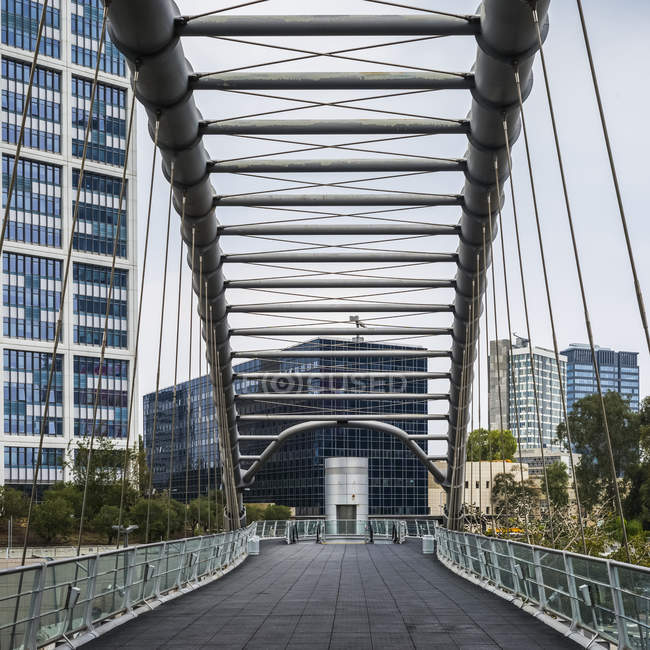 Kirya Bridge at buildings on background — Stock Photo