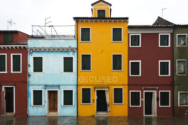 Colourful houses in row — Stock Photo