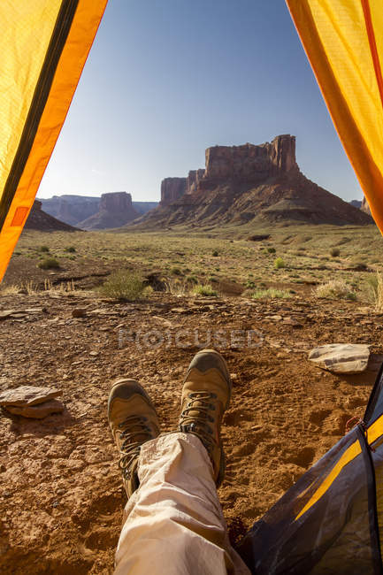 Campers feet out of tent — Stock Photo