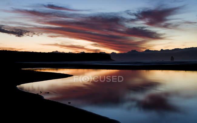Захід сонця на пляжі Rapahoe — стокове фото