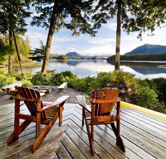Wooden adirondack chairs — Stock Photo