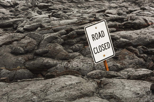 Road sign covered with Pahoehoe lava — Stock Photo