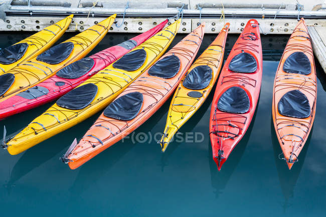 Empty colorful kayaks drifting on water — Stock Photo