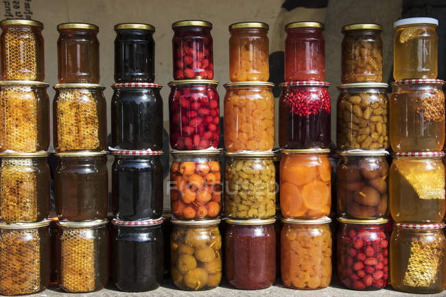 Jars with fruit preserves — Stock Photo