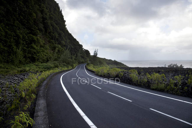 Seafront road under dramatic sky — Stock Photo