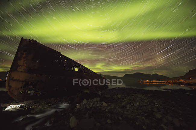 Star trails and northern lights — Stock Photo